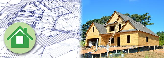 A single family home under construction next to blueprint plans