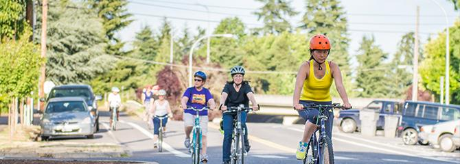People riding bikes in a Vancouver neighborhood