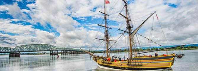Photo of a vintage sailing ship heading east towards the I-5 bridge on the Columbia River