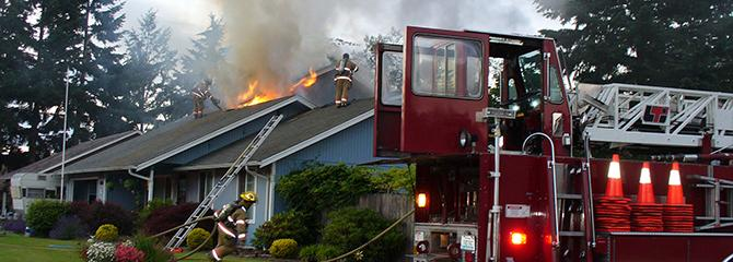 Photo of Vancouver Fire fighters putting out a home fire