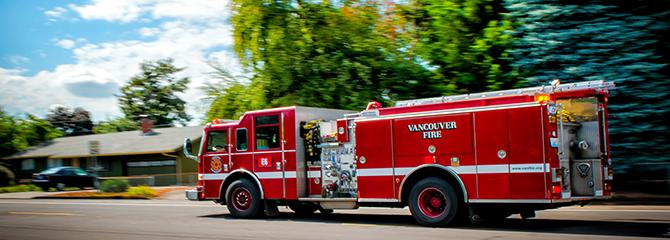 Photo of Vancouver Fire truck driving down a neighborhood street
