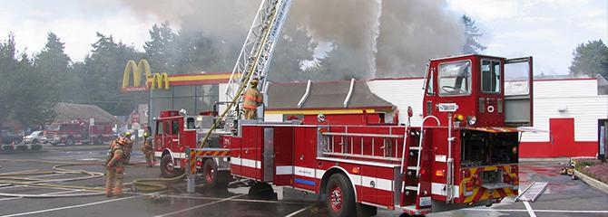 Photo of a Vancouver Fire Department ladder truck responding to a fire