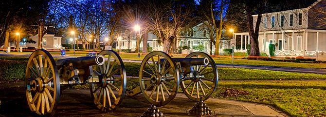 Officer's Row cannons at night