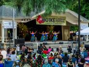 Photo of Hawaiian dancers performing on the main stage in Esther Short Park