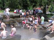 Photo of children playing in the fountain at Propstra Square in the park