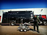 Officer with robot and SWAT/MEDU truck