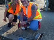 Installing storm drain medallions help as a reminder that what goes in the drain flows to the river
