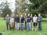 Clark College students planting a tree