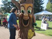 Susan hugging Friends of Trees mascot Garry Oak