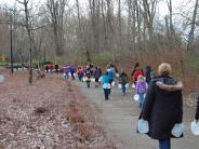 Walk for Water image - group walking on trail