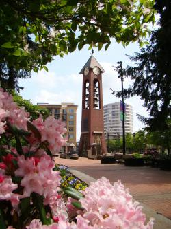 Salmon Run Bell Tower with flowers at Esther Short Park