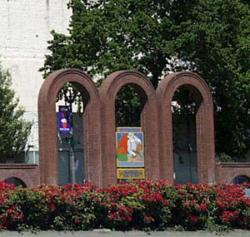 Three Brick Arches at freeway enterance with farmers market sign