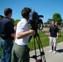 Photo of a CVTV production crew interviewing a government employee
