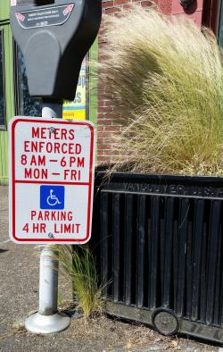 Picture of parking sign with 4-hr disabled parking limit