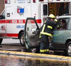 An ambulance and Vancouver Fire Department personnel respond to the scene of a car accident.