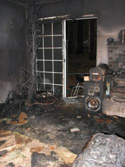 This fire investigation photo shows the level of devastation that a Vancouver family suffered. The cause was determined to be heat from improper tree lights combined with the tree not having water to keep it moist.