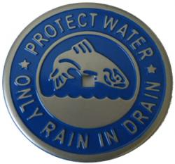 Storm drain medallions remind us that stormwater drains lead to rivers and streams