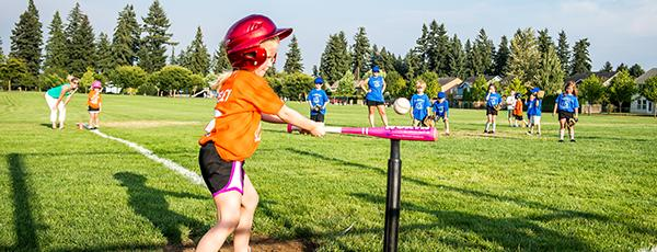 Young girl playing T-ball in Vancouver, Washington