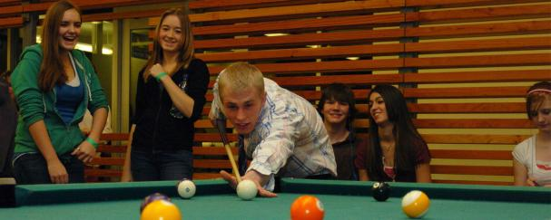Teens playing pool at Firstenburg Community Center
