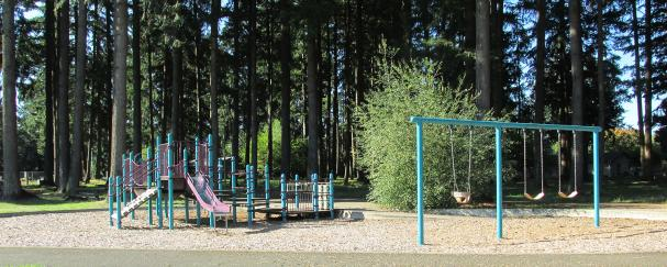 Playground and wooded walking paths at Burnt Bridge Creek School Park