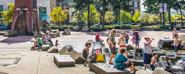 Children playing in water feature at Esther Short Park in downtown Vancouver, Washington