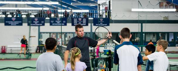 Brent Waddle instructing junior tennis players