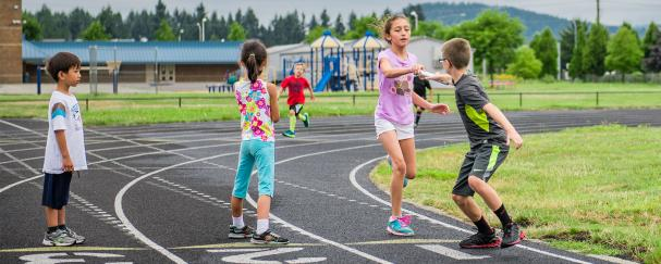 Kids passing the baton during Track & Field Camp