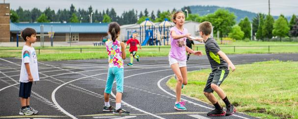 Kids participating in track day at a Parks & Recreation day camp