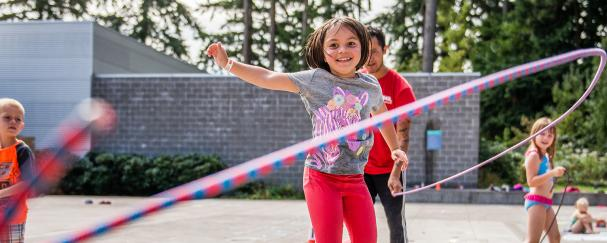 Young girl playing jump rope outside Firstenburg Community Center