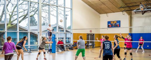 Women playing volleyball in the Marshall Community Center gym