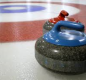 Curling discs on ice.