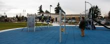 Kids playing on the playground outside the East Police Precinct in Vancouver