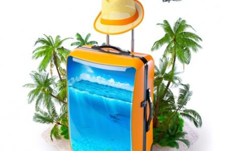 Suitcase with a woven hat on top.