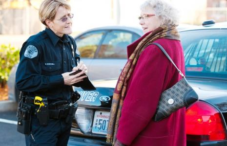 Female police officer talking to a woman.