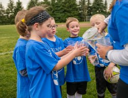 Young soccer players drinking water