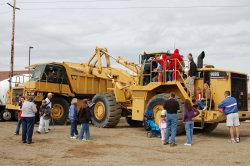 Kids playing on construction equipment.
