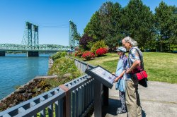 Senior couple review an interpretive sign on Waterfront Trail