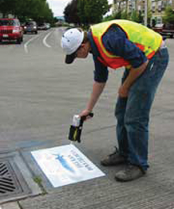 Stencils remind us that stormwater drains lead to rivers and streams
