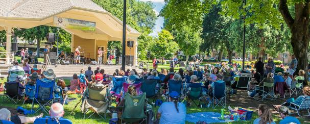 Crowd gathers in front of the concert stage at Esther Short Park for a noon concert.